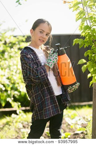 Girl Exterminating Insects In Garden With Toxic Spray