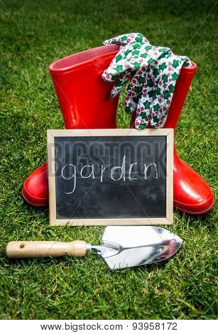 Garden Tools And Blackboard With Word