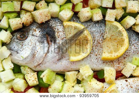 Fish Dorado With Vegetables And Lemon