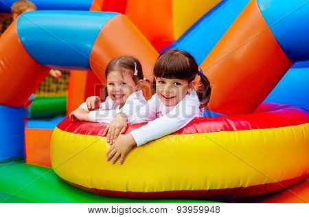 Happy Kids, Girls Having Fun On Inflatable Attraction Playground