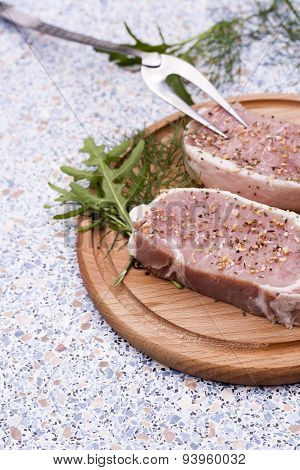 Fresh Raw Steak Meat with spaces and herbs