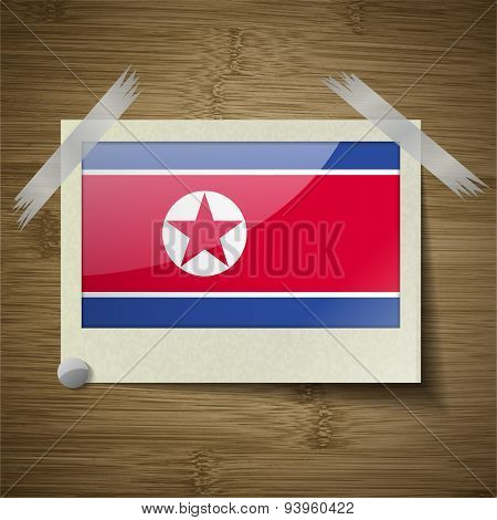 Flags Korea North At Frame On Wooden Texture. Vector