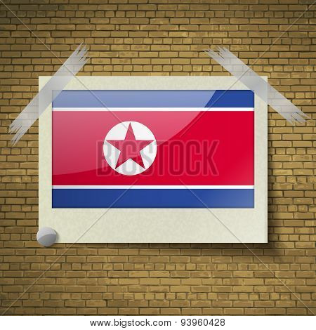 Flags Korea North At Frame On A Brick Background. Vector