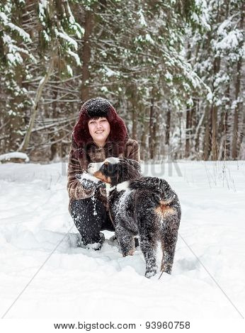 Girl with mountain dog
