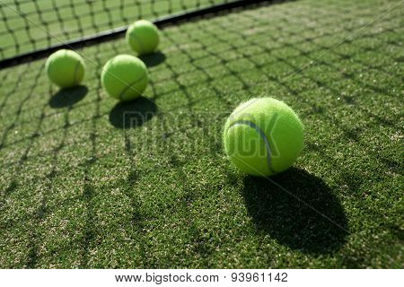 Tennis Balls On Tennis Grass Court