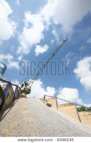 The big crane in cement factory with nice sky.