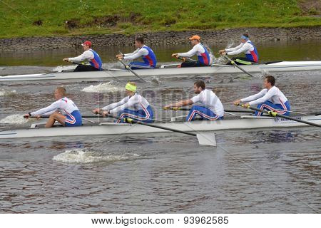 ST. PETERSBURG, RUSSIA - JUNE 12, 2015: Sweep rowing competition on fours boats during the Golden Blades Regatta. It is is one of the best known regatta in Russia