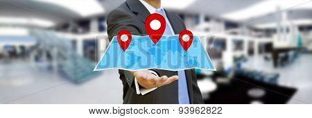 Businessman Holding Digital Map In His Hands