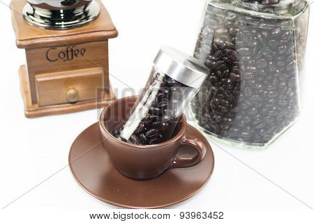Coffee Bean Glass Bottle In Coffee Cup