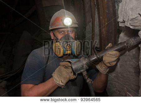 Donetsk, Ukraine - March, 14, 2014: Miner Working Underground In The Mine Named After Abakumov