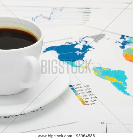 Coffee Cup Over World Map And Some Financial Documents - Business Concept