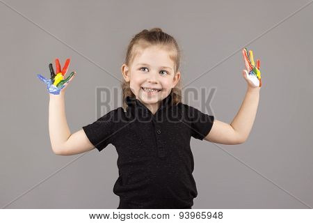 Little Girl Shows The Hands Painted
