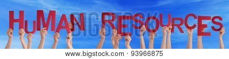 People Holding Red Word Human Resources Blue Sky