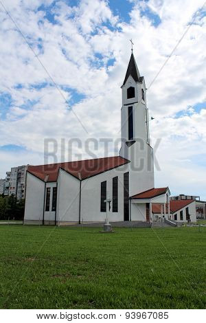 Modern white church on a cloudy summer day