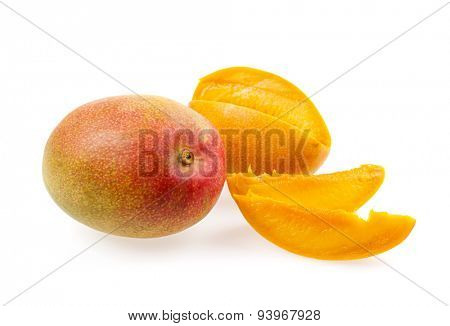 Whole and cut mangos with mango fruit slices isolated on white background