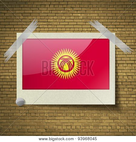 Flags Kyrgyzstan At Frame On A Brick Background. Vector