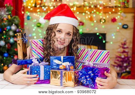 Beautiful Girl With A Bunch Of Christmas Gifts