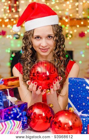 The Girl Is Holding A Big Christmas Ball