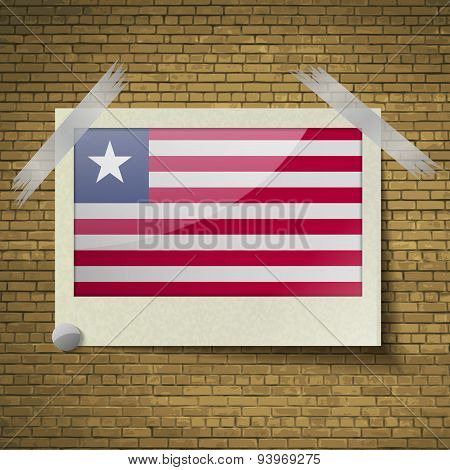 Flags Liberia At Frame On A Brick Background. Vector