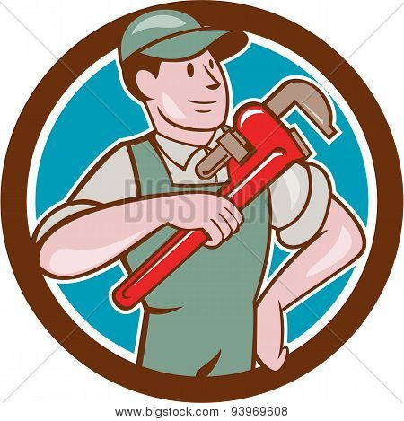 Plumber Pointing Monkey Wrench Circle Cartoon