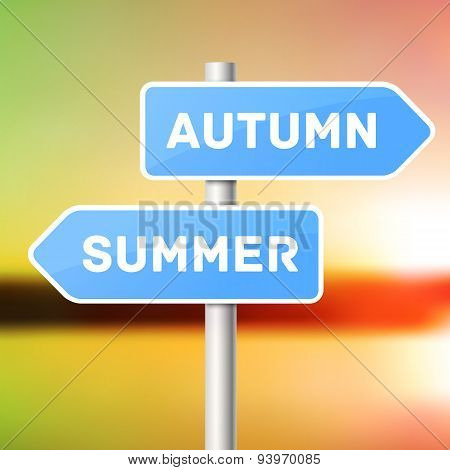 Blue sign post with directional arrows, summer arrow and autumn arrow.