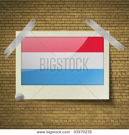 Flags Luxembourg At Frame On A Brick Background. Vector