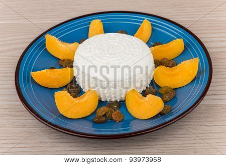 Curd With Raisins And Slices Of Peach In Plate