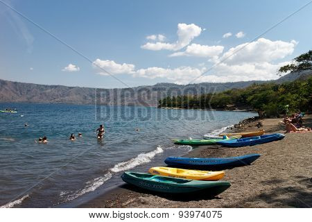 Laguna De Apoyo, Nicaragua- March 28 2015: People Swimming In Lake And Kayaks Around