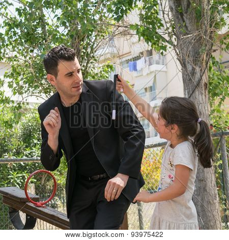 Park in Athens Greece. 17 May 2015.  Magic tricks with tristan the Magician.