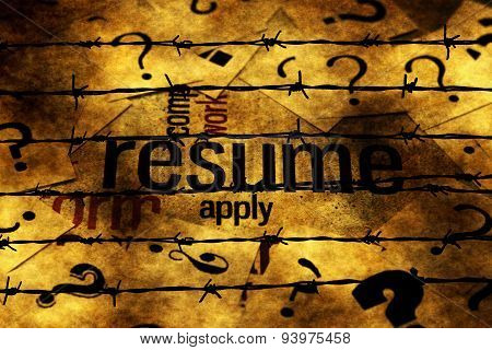 Resume And Question Marks Against Barbwire