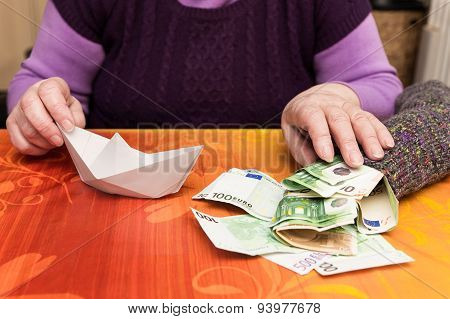 Senior With A Sock Full Of Money