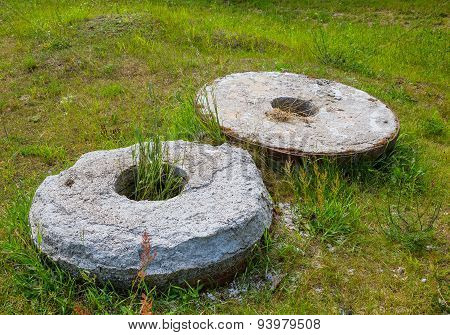 Two Old Stone Millstone