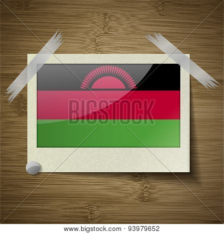 Flags Malawi At Frame On Wooden Texture. Vector