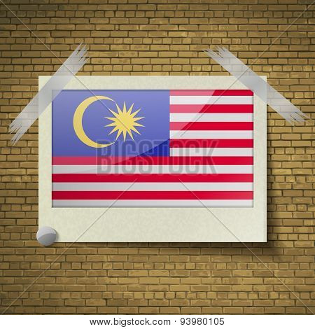 Flags Malaysia At Frame On A Brick Background. Vector
