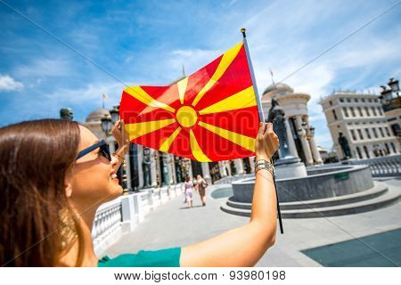Woman with macedonian flag in Skopje city center