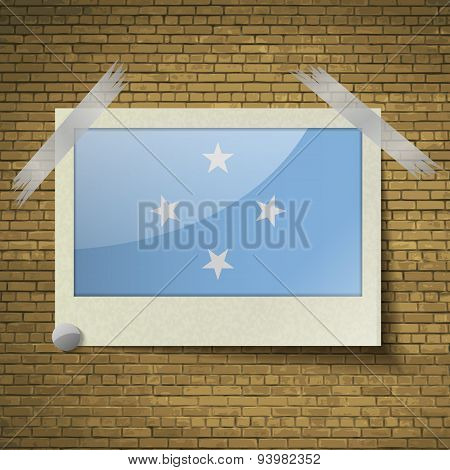 Flags Micronesia At Frame On A Brick Background. Vector