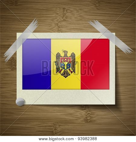 Flags Moldova At Frame On Wooden Texture. Vector