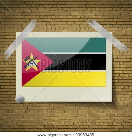 Flags Mozambique At Frame On A Brick Background. Vectorat Frame On A Brick Background. Vector