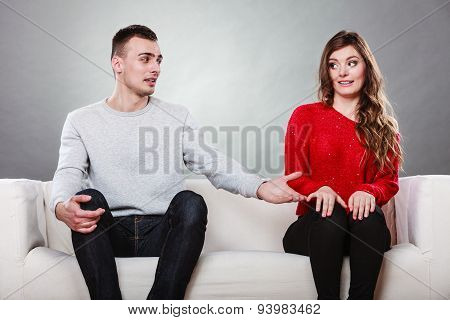 Shy Woman And Man Sitting On Sofa. First Date.