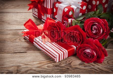 Roses And Boxes With Gifts On The Old Board