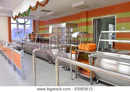 NOVOSIBIRSK, RUSSIA - JANUARY 15, 2015: Staff prepare the student canteen of State University of Economics and Management for meal time. It's the Western Siberia largest economical university