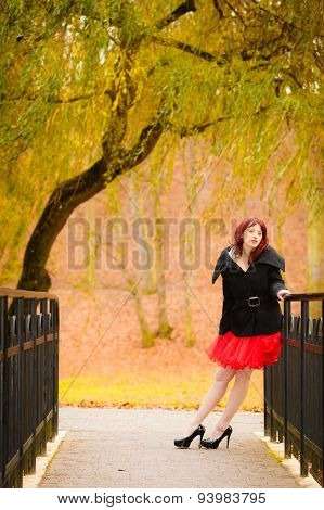 Fashion Woman Relaxing Walking In Autumn Park