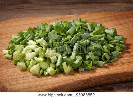 The Cut Fresh Onions Lying On The Board