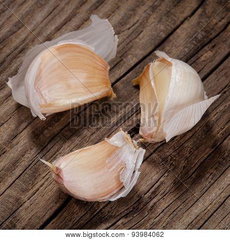 Garlic Cloves On An Old Board