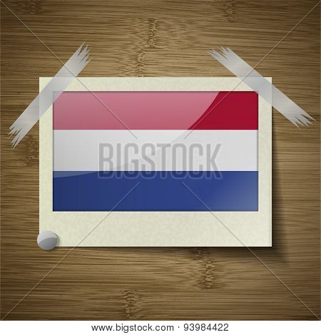 Flags Netherlands At Frame On Wooden Texture. Vector