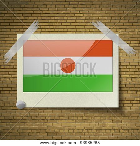 Flags Niger At Frame On A Brick Background. Vectorat Frame On A Brick Background. Vector