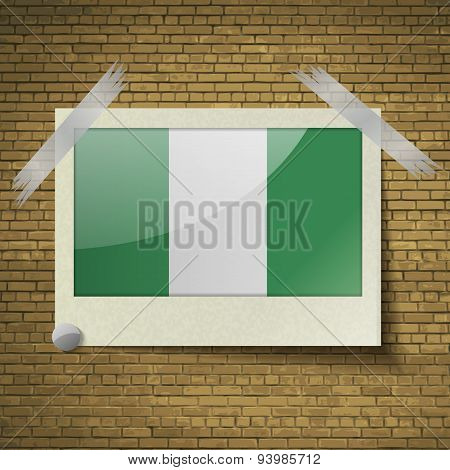 Flags Nigeriaat Frame On A Brick Background. Vector