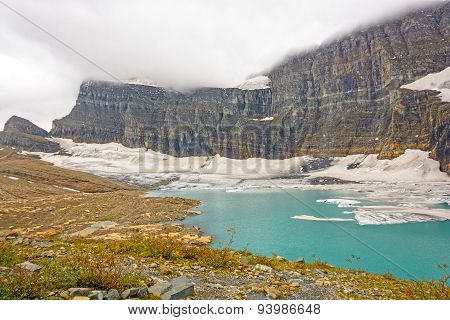 Alpine Glacier And Lake On A Cloudy Day