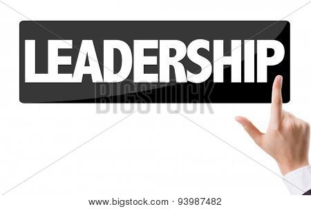 Businessman pressing button with the text: Leadership
