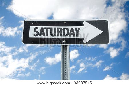 Saturday direction sign with sky background